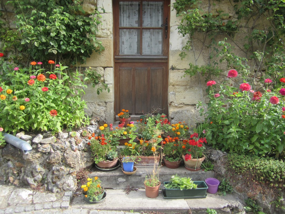 Flowers by doorways