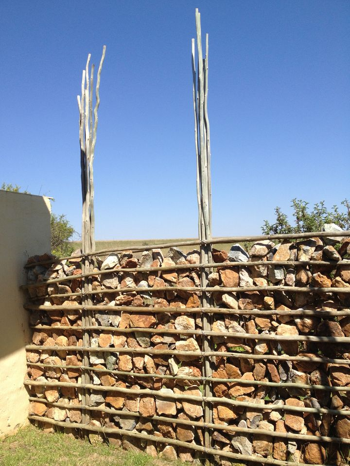 Clever African stone walls dividing rooms