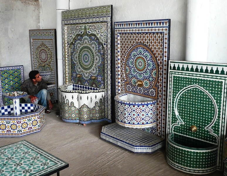 Brightly coloured mosaic wall fountains