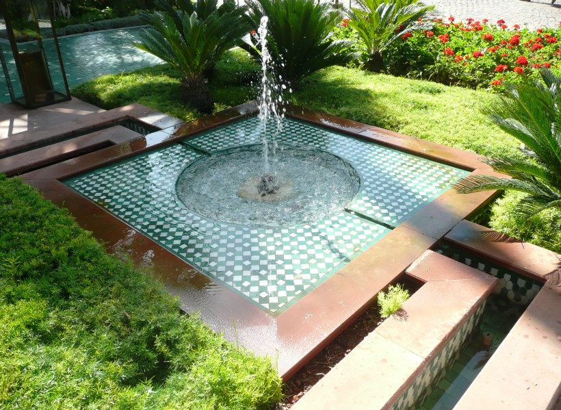 Hotel La Mamounia - Pond and rill nestled into the garden, surrounded by asparagus fern