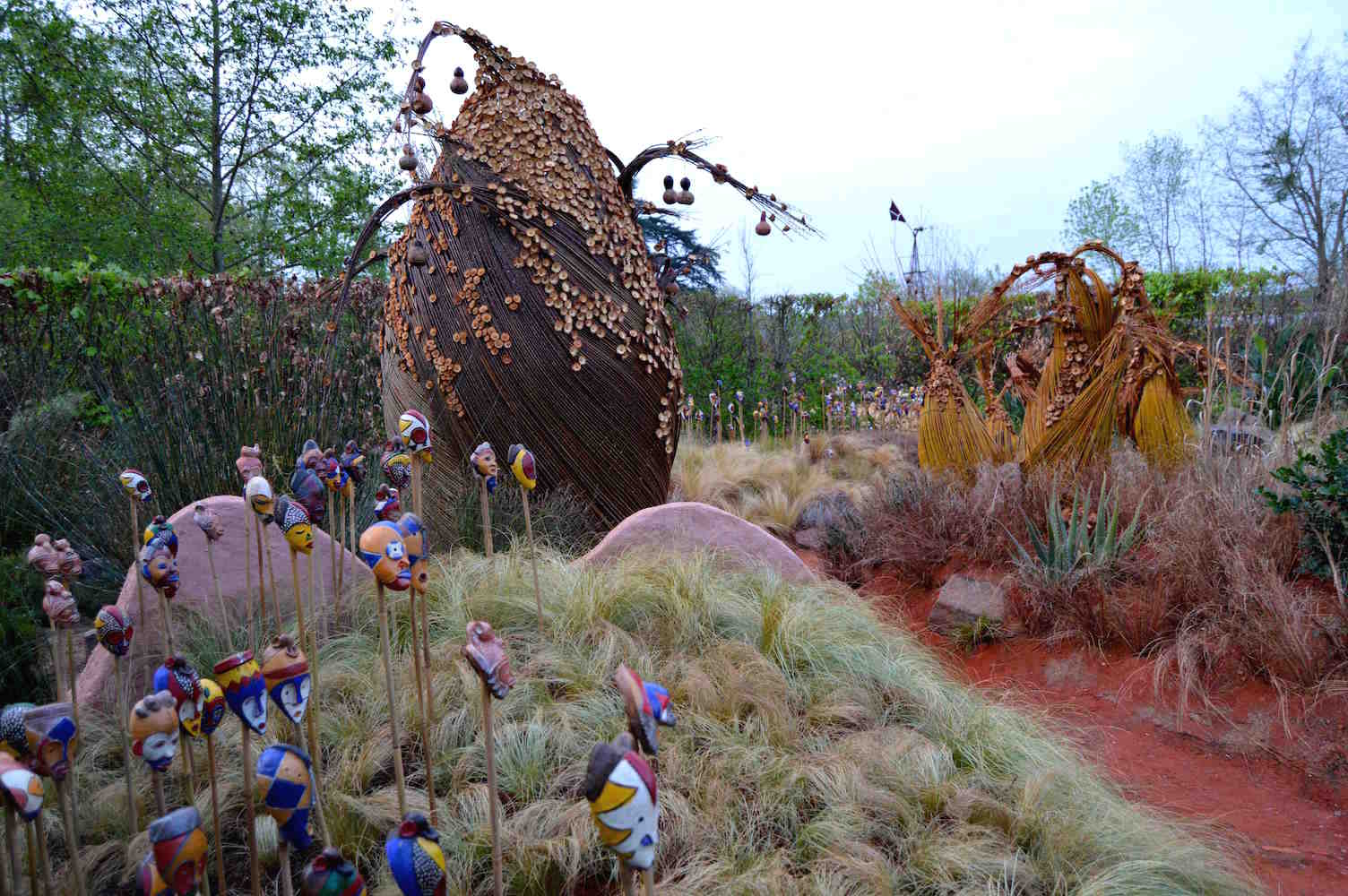 Baobab sculpture and Passport masks in 'African Kitchen' garden, design Leon Kluge