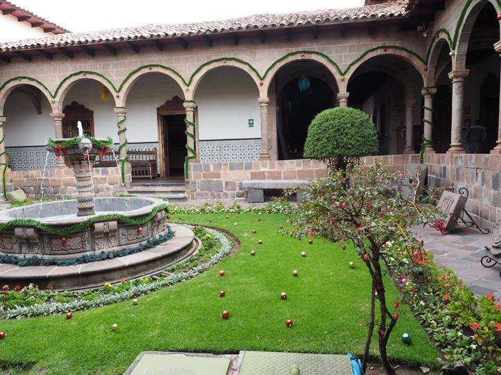 A medieval-style cloister garden built for reflection in the Museo Arzobispal. Spectacular cultural festivals – a common feature in Cusco.