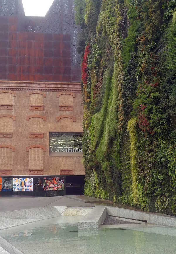 Caixa Forum Greenwall, Madrid, with adjacent exhibition building and forecourt pond