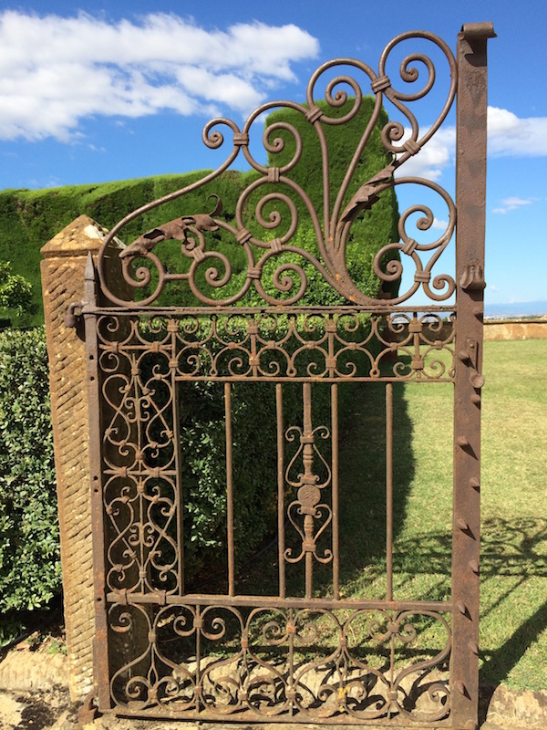 Gate into the formal water garden at Villa Gamberaia